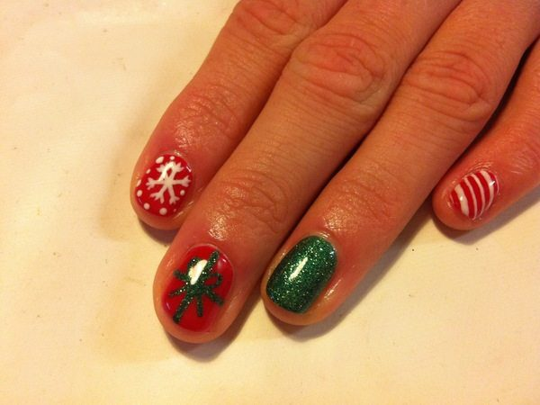 Red and Green Nails with Candy Cane Stripes and Snowflakes