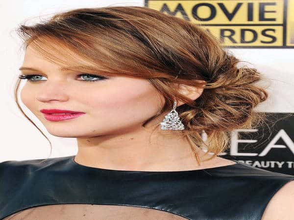 Jennifer Lawrence with Side Swept Bangs and Bun