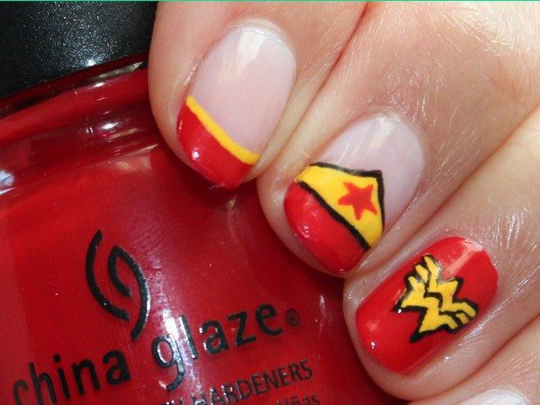 Plain Nails with Red Tips, a Yellow Tiara, and One Red Nail with Wonder Woman Symbol