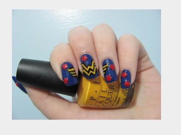 Blue Nails with the Yellow Wonder Woman Symbol and Red Stars