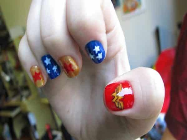Blue and Gold Nails with Red Thumb Nail and Star Decorations