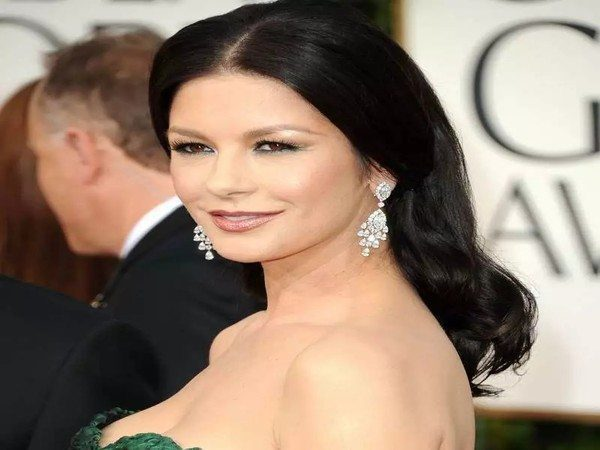 Catherine Zeta-Jones Brunette Middle Parted Hair and Straightened In Front