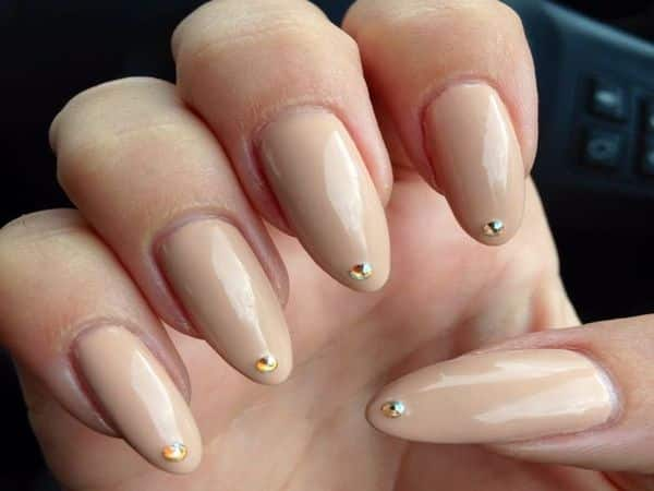 Long Nude Nails with Gold Bead Tip