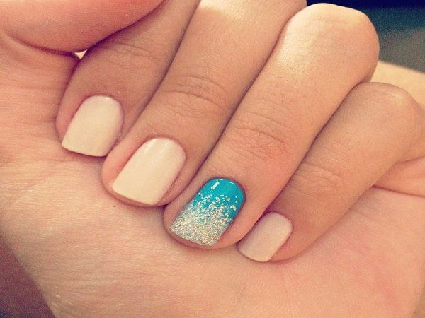 Nude Nails with Blue Nail and Silver Glitter Tip