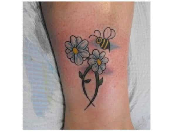 White Daisies with Blue Accents and Bee Tattoo
