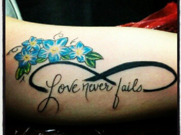 Love Never Fails Infinity Tattoo with Blue Flowers