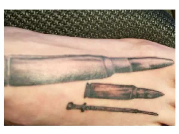 Two Bullets and Sword Foot Tattoo