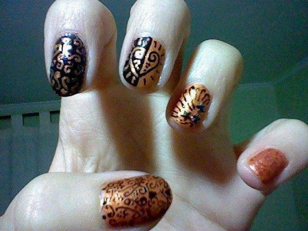 Copper and Black Nails with Swirls and Heart Decorations