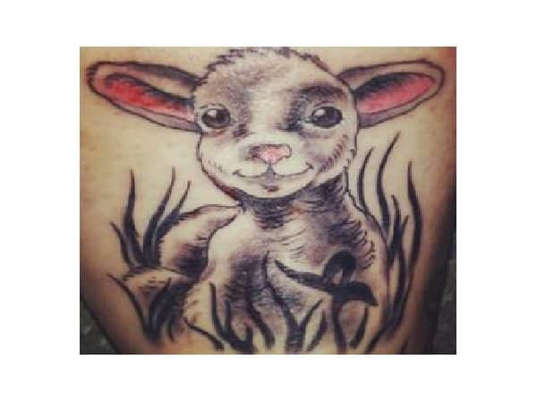 Smiling Lamb with Grass Tattoo