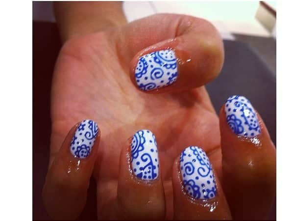 White Nails with Blue Paisley Designs