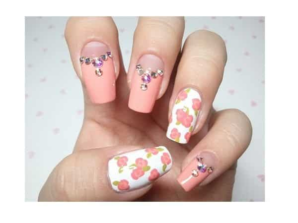 Pretty In Pink Nails with Flowers and Rhinestones and Two White Nails