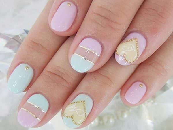 Pastel Pink and Green Pastel Nails with Gold Stripes and Yellow Gold Dotted Outlined Heart Decorations
