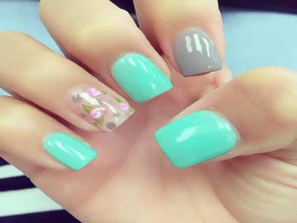 Turquoise Nails with One Grey Nail, and One Clear Nail with Pink Flowers