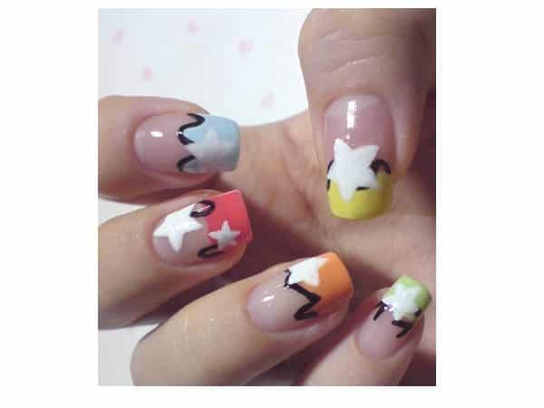Yellow, Blue, Red, Orange, and Green Tipped Nails with Black Squiggles and White Stars