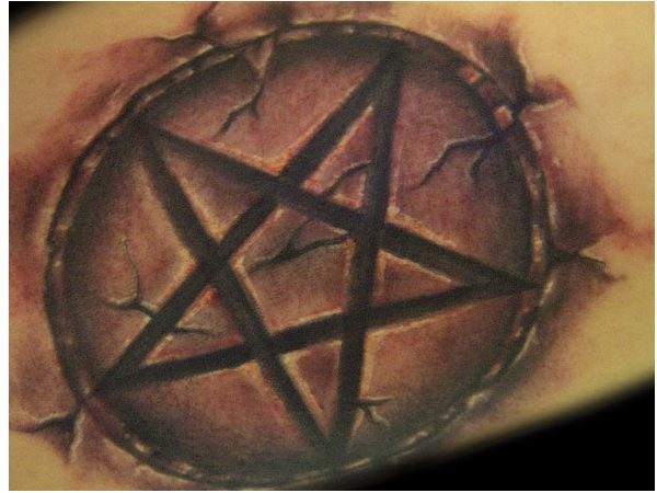 Bursting Out of the Skin Pentagram Tattoo