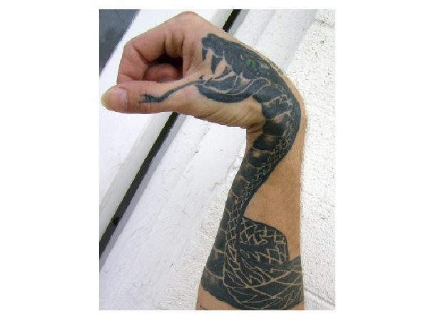 Black Ink Arm and Hand Hissing Snake Tattoo