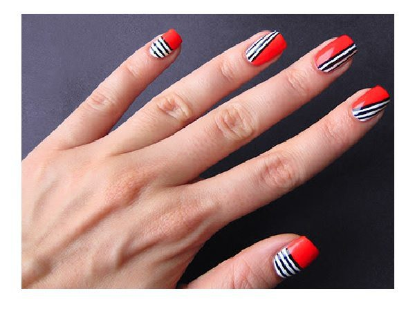 Orange Nails with Black and White Stripes
