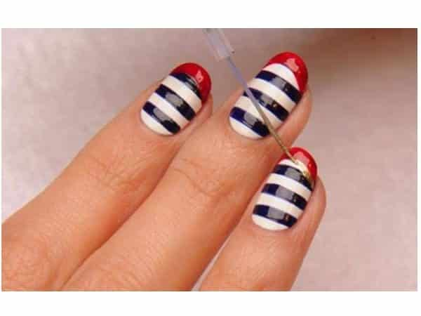 Blue and White Striped Nails with Red Striped Tips