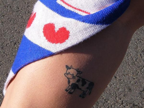 Tiny Colored Cow Arm Tattoo