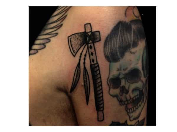 Tiny Tomahawk Tattoo with Long Feathers