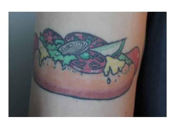Hot Dog Tattoo with Mustard, Guacamole, Onions, Tomatoes, and a Pickle