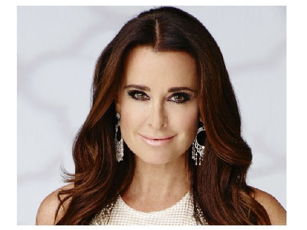 Kyle Richards with Long Dark Hair and Light Brown Streaks