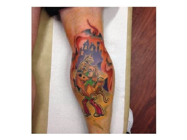 Scooby Doo and Shaggy Plus Haunted Castle and Bats Leg Tattoo