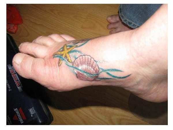 Seashell and Starfish Tattoo with Blue Water Lines Foot Tattoo