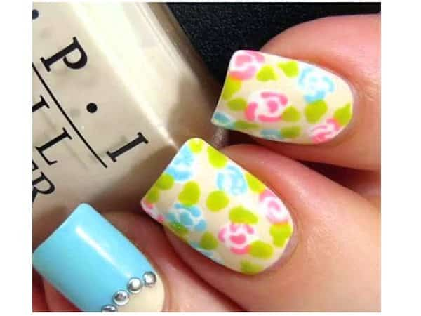 Pink and Blue Flower Nails with Blue Nail and Rhinestones