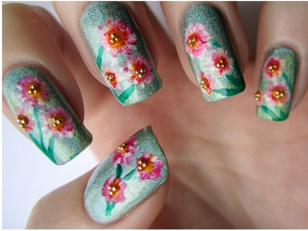 Light Green Nails with Pink Flowers and Gold Dot Centers