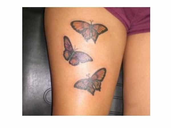Three Colored Butterfly Thigh Tattoo