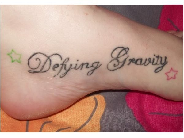 Defying Gravity with Stars Foot Tattoo