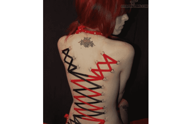 Corset Piercing With Wings