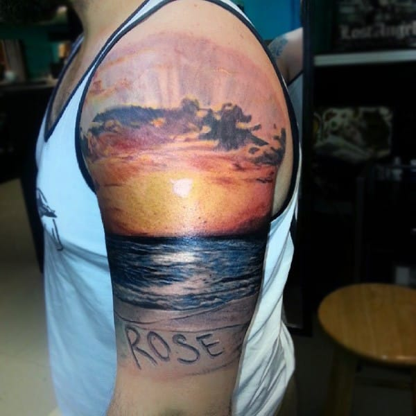 """ae9575f4b2fc8 A Nice Ocean Beach Sunset, With """"Rose"""" Etched In The Sand. 6. A Colorless  Ocean Sunset Upper Arm Tattoo"""