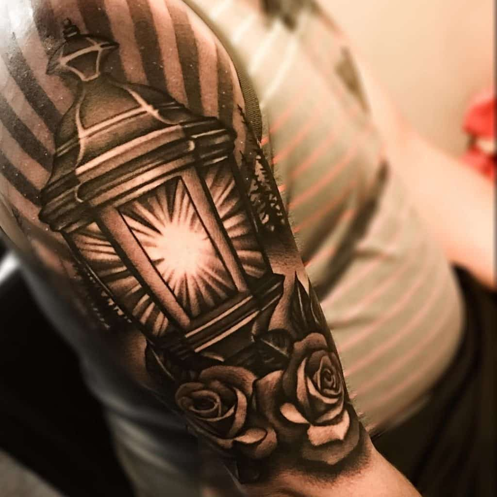 A Graphic Lantern Upper Arm Tattoo