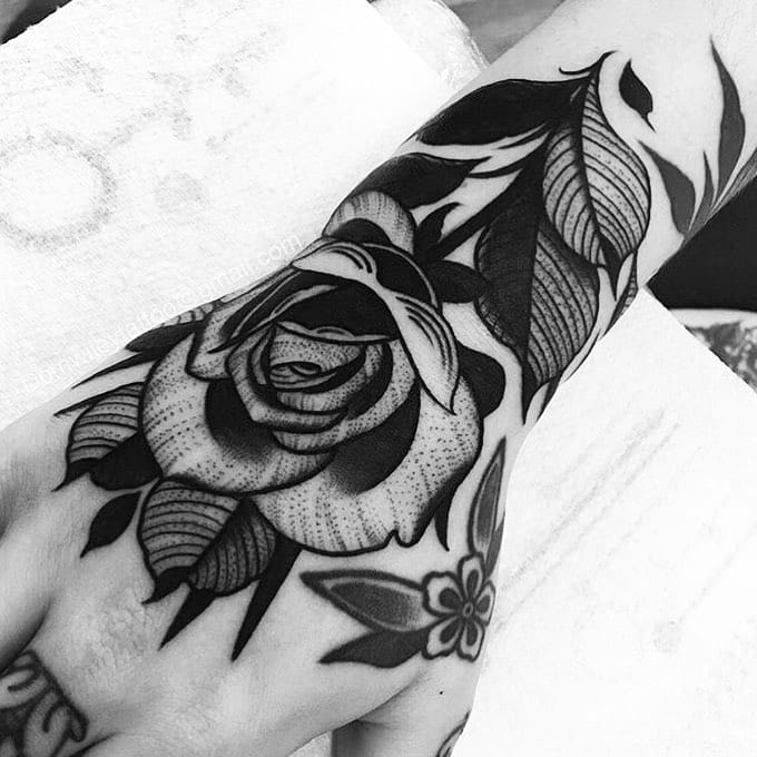 Black and White Rose hand tattoos for women
