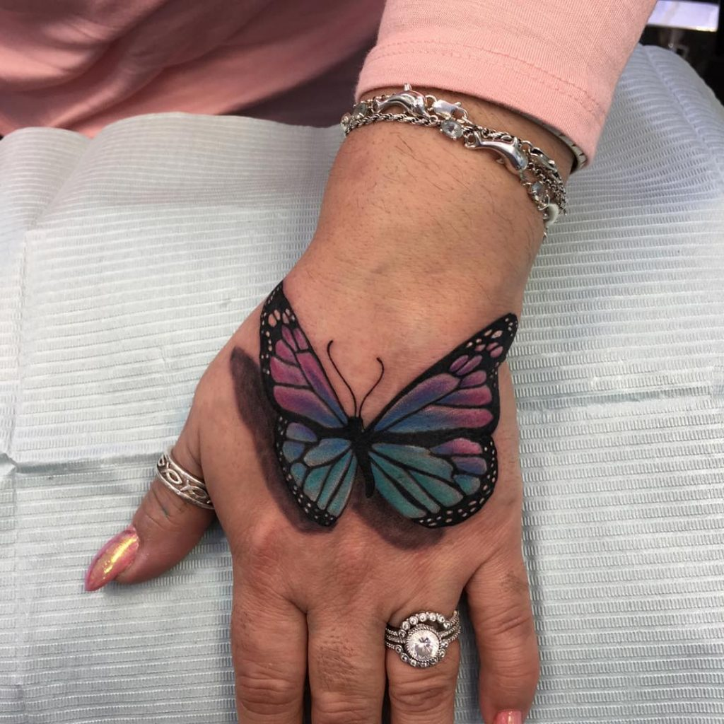Butterfly effect hand tattoo for women