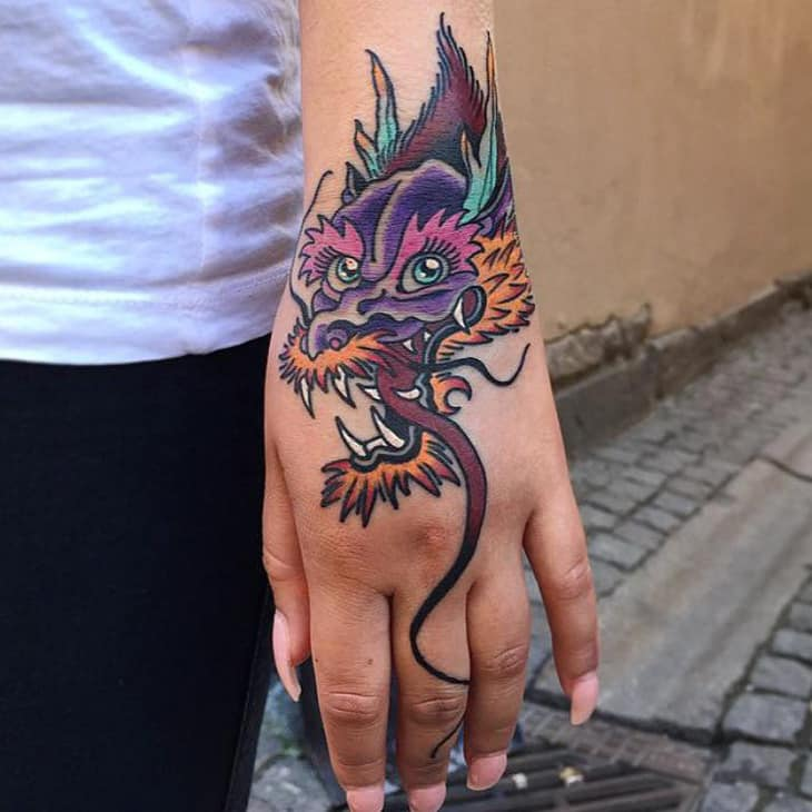 Colorful Dragon hand tattoos for women