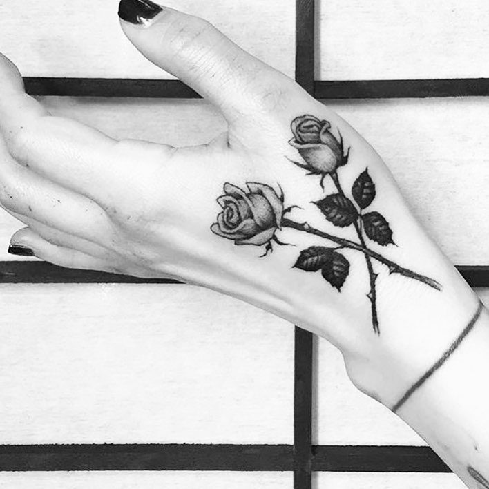Monochrome Roses hand tattoos for women