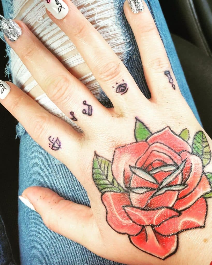 Red Roses and other cute stuff hand tattoos for women