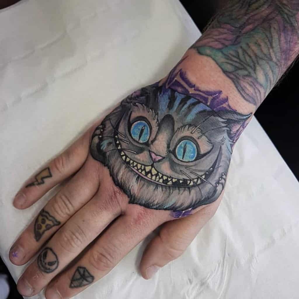 Cheshire Cat on the hand alice in wonderland Tattoo