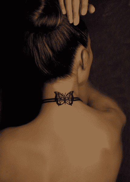 butterfly and a ribbon neck tattoos for women